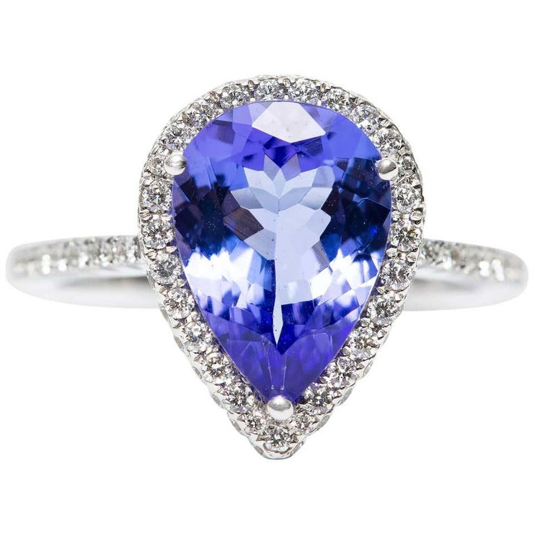 Pear Cut 3.26 CT Pear Tanzanite Certified 0.75 Carat Diamond 18 KT Gold Engagement Ring For Sale