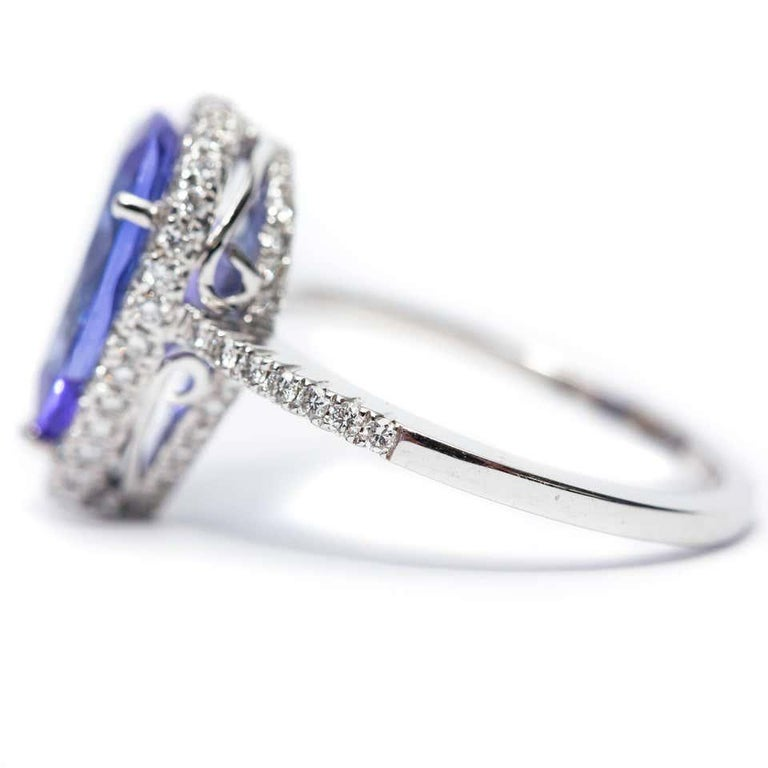 3.26 CT Pear Tanzanite Certified 0.75 Carat Diamond 18 KT Gold Engagement Ring For Sale 8