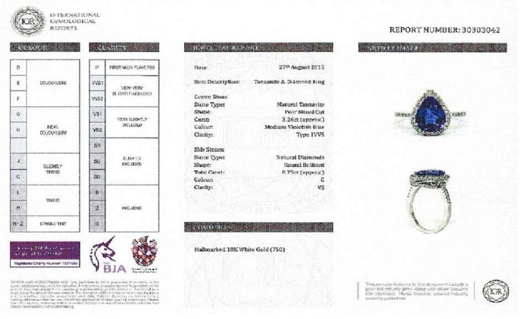 3.26 CT Pear Tanzanite Certified 0.75 Carat Diamond 18 KT Gold Engagement Ring For Sale 12