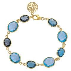 32.78 Carat Blue Topaz 18 Karat Yellow Gold Simple Bracelet