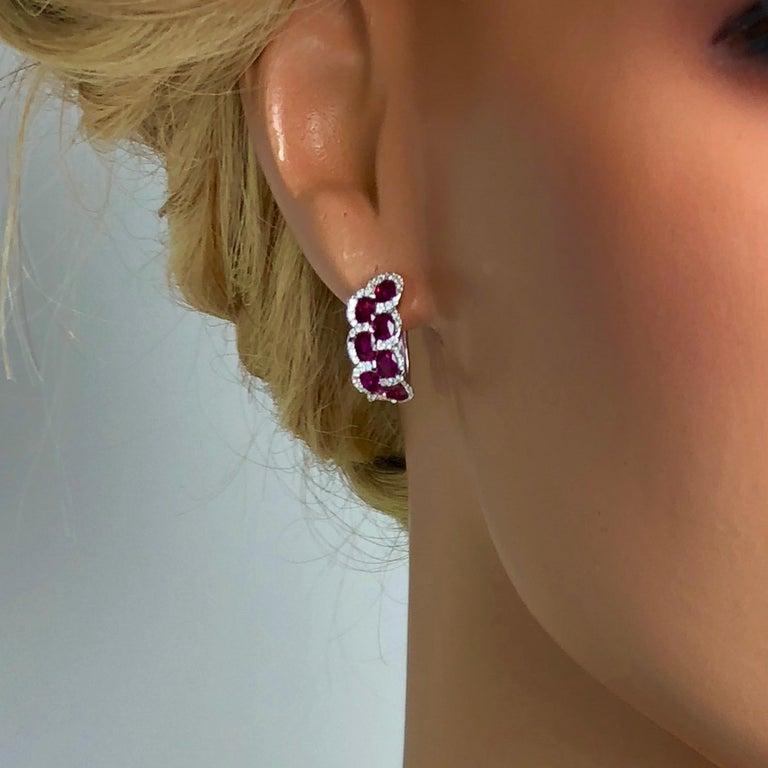 Women's 3.28 Carat Oval Cut Ruby Lever-back Earrings in White Diamond Halo For Sale