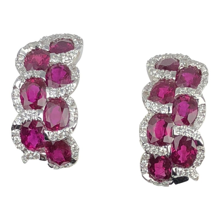3.28 Carat Oval Cut Ruby Lever-back Earrings in White Diamond Halo For Sale