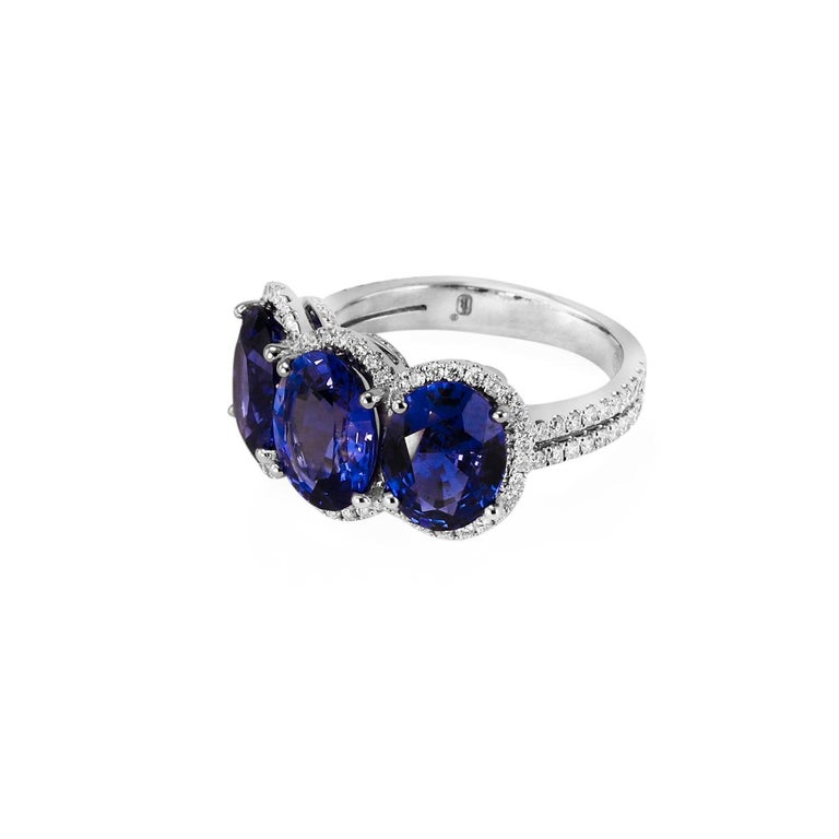 3.28 ct. oval cut Sapphire .33 ctw. round brilliant Diamonds G-H/VS 18K white gold