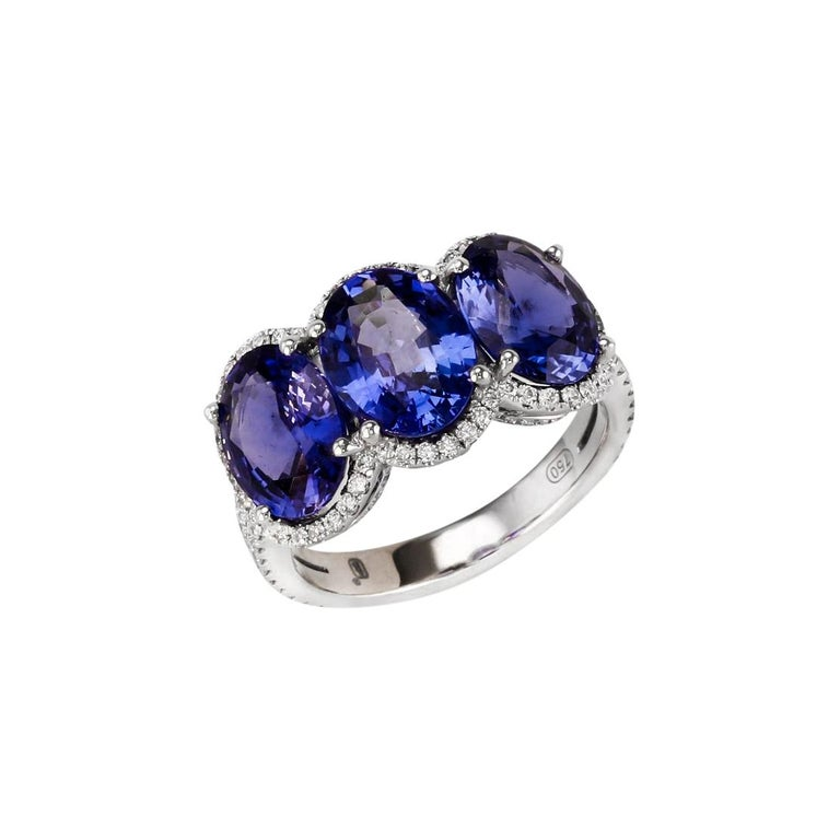 3.28 Carat Oval Sapphire Diamond Three-Stone Ring For Sale
