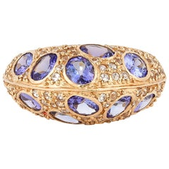 3.29 Carat Tanzanite and White Sapphire Ring in 14 Karat Rose Gold