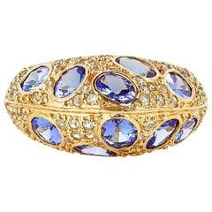 3.29 Carat Tanzanite and White Sapphire Ring in 18 Karat Yellow Gold