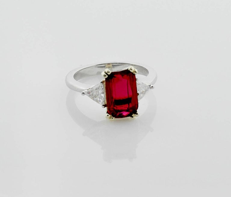 3.31 Emerald Cut Ruby and Diamond Solitaire Ring in Platinum and 18k GIA Certified Handmade Classic Design Ruby weighs 3.31  [bright with no imperfections visible to the naked eye] Two Round Trillion Cut Diamonds weighing .48 carats