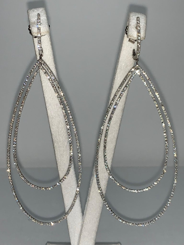 Delicate Double Tear Drop Shaped 18K White Gold Earrings are enhanced by White Pave Diamonds.  Stunning earrings that make a statement yet are subtle at doing so.  3.32 Carat White Pave Diamonds 3.32CT Diamonds Handcrafted  We specialize in unique,