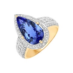 3.32 Carat Genuine Tanzanite and White Diamond 14 Karat Yellow Gold Ring