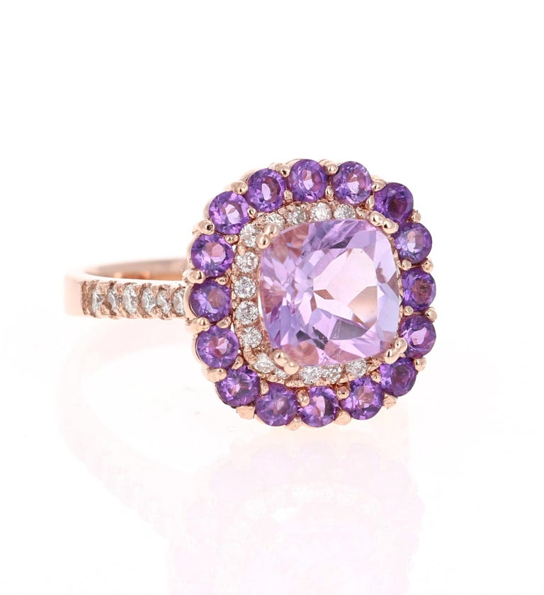 Amethyst and Diamond Cocktail Ring!   Playful yet Powerful! Its like having a piece of glittery candy on your finger! This ring has a light purple Cushion Cut Amethyst that weighs 2.29 Carats and is embellished with 16 Amethysts that weigh 0.87