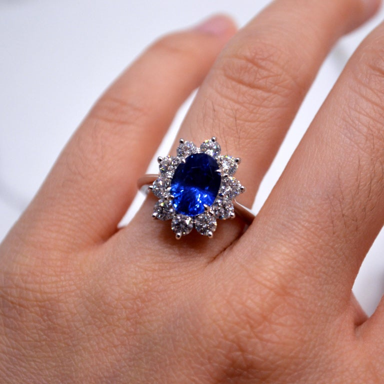Princess Diana Style Ring in 18K white gold set with an oval cut Ceylon Blue Sapphire (3.33 carat) and 10 round brilliant cut Diamonds (1.25 carats)  Ring US size 6.5 *Complimentary resizing service*