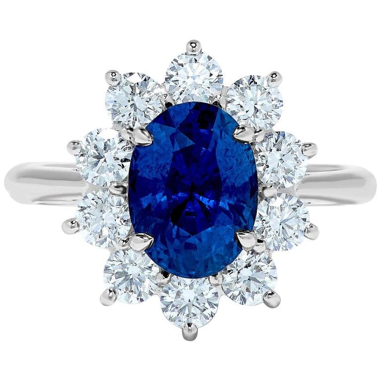 3.33 Carat Ceylon Blue Sapphire Diamond Halo 18 Karat Gold Princess Diana Ring For Sale