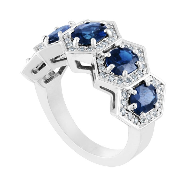 Five Stone Hexagon Band Ring The ring is 14K White Gold The ring has 5 Oval Sapphires 3.33 Carats The ring has 0.50 Carats Diamonds F/G VS The ring is a size 7.00, sizable up only. The ring weighs 8.6 grams