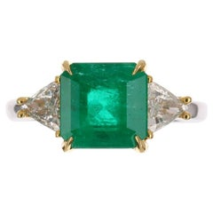 3.33tcw GIA 18K Three Stone Colombian Emerald & Trillion Diamond Ring