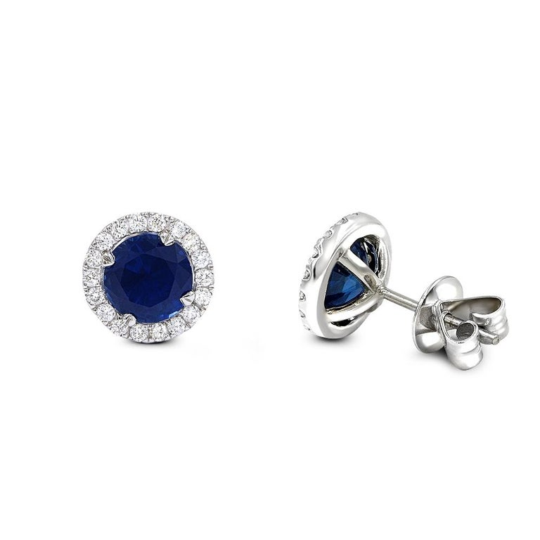 Magnificent diamond sapphire stud earrings.  Crafted in 14k white gold. 3.34ct blue sapphires .47ct diamonds handset in prong setting. Diamonds are VS2 clarity G color . The earrings have secure push backs.