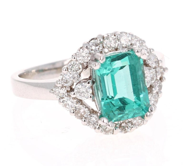 3.34 Carat Emerald Cut Apatite Diamond White Gold Engagement Ring!  Gorgeous Apatite and Diamond Ring.  This ring has a 2.63 carat Emerald-Cut Apatite in the center of the ring and is surrounded by 22 Round Cut Diamonds that weigh 0.71 carat