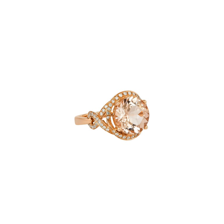 This collection features an array of magnificent morganites! Accented with diamonds these rings are made in rose gold and present a classic yet elegant look.   Classic morganite ring in 18K rose gold with diamonds.   Morganite: 3.34 carat round