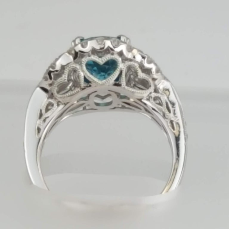 DiamondTown 3.34 Carat Oval Cut Blue Zircon and Diamond Halo Ring In New Condition For Sale In New York, NY