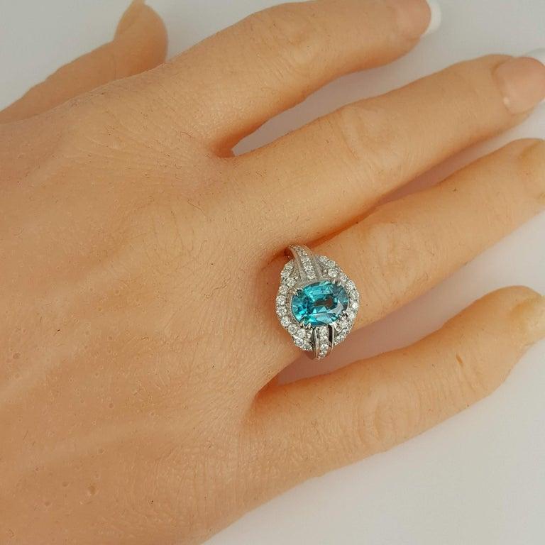 DiamondTown 3.34 Carat Oval Cut Blue Zircon and Diamond Halo Ring For Sale 1