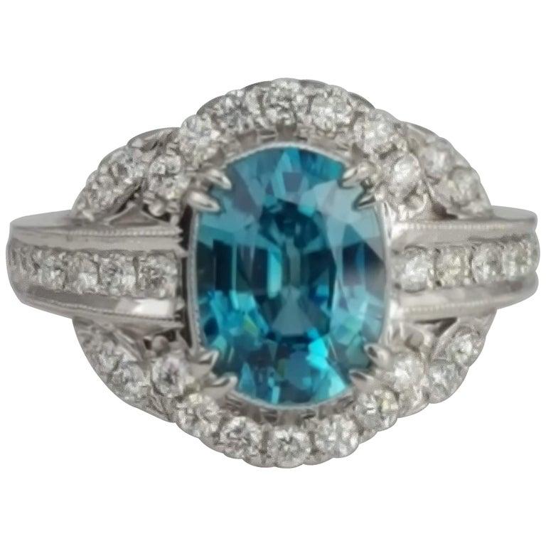 DiamondTown 3.34 Carat Oval Cut Blue Zircon and Diamond Halo Ring For Sale