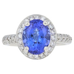 3.34 Carat Oval Cut Tanzanite and Diamond Ring, Platinum Milgrain Halo