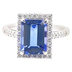 3.36 Carat Step-Cut Tanzanite and Diamond Ring Set in Platinum
