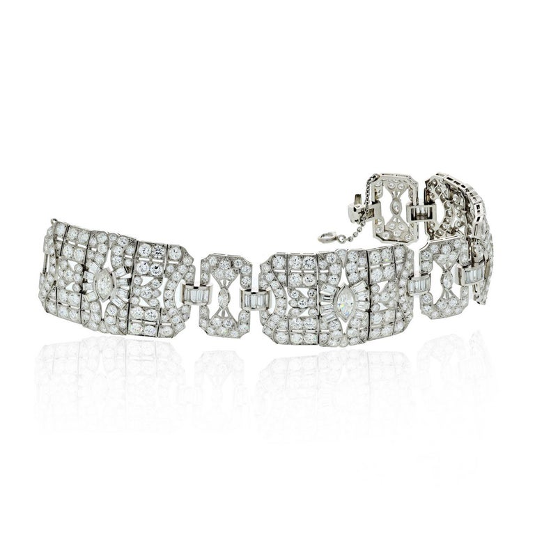 An incredible Art Deco bracelet features 30 carats of marquise, baguette, and single cut diamonds set in platinum for a detailed and artistic look. The marquise shaped diamonds anchor the piece with large open spaces and baguette-cut diamonds are
