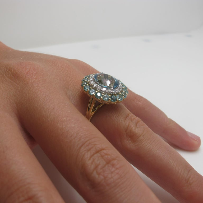 Artisan 3.37 Oval Aquamarine, Blue Zircon, and White Diamond 18 Karat Yellow Gold Ring For Sale