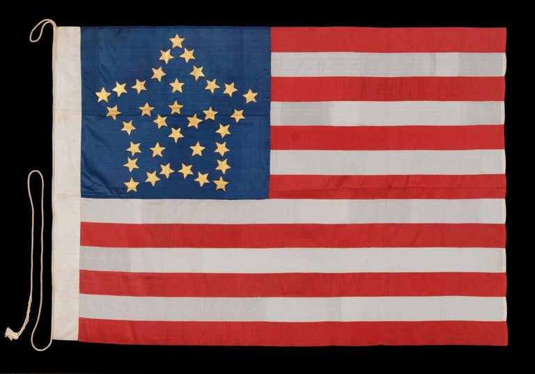 "34 GILT PAINTED STARS IN A BOLD REPRESENTATION OF THE ""GREAT STAR"" PATTERN, ON A SILK, ANTIQUE AMERICAN FLAG MADE DURING THE OPENING YEARS OF THE CIVIL WAR, 1861-63, PROBABLY MADE UNDER MILITARY CONTRACT OR FOR USE BY LOCAL MILITIA, ENTIRELY"