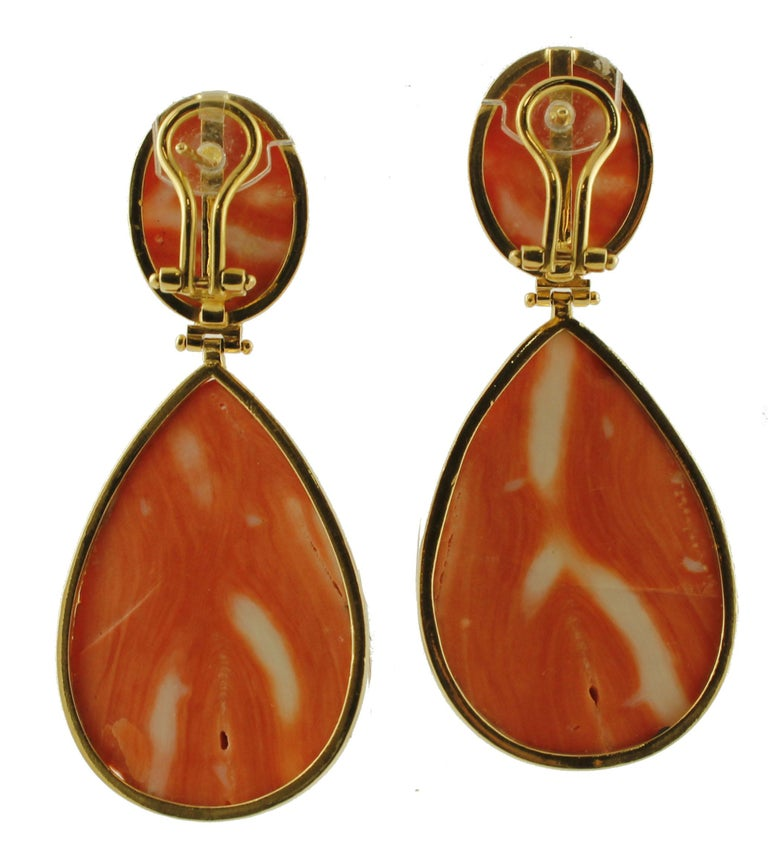 Marvelous pair of dangle earrings in 18k yellow gold structure, realized with 34.1g of elatius coral finely carved by Italian master goldsmiths.  These earrings are totally handmade following the ancient neapolitan tradition of coral