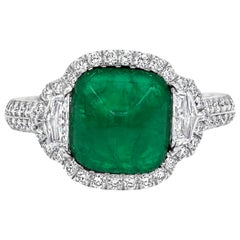 3.42 Carat Cabochon Emerald and Diamond Halo Three-Stone Ring