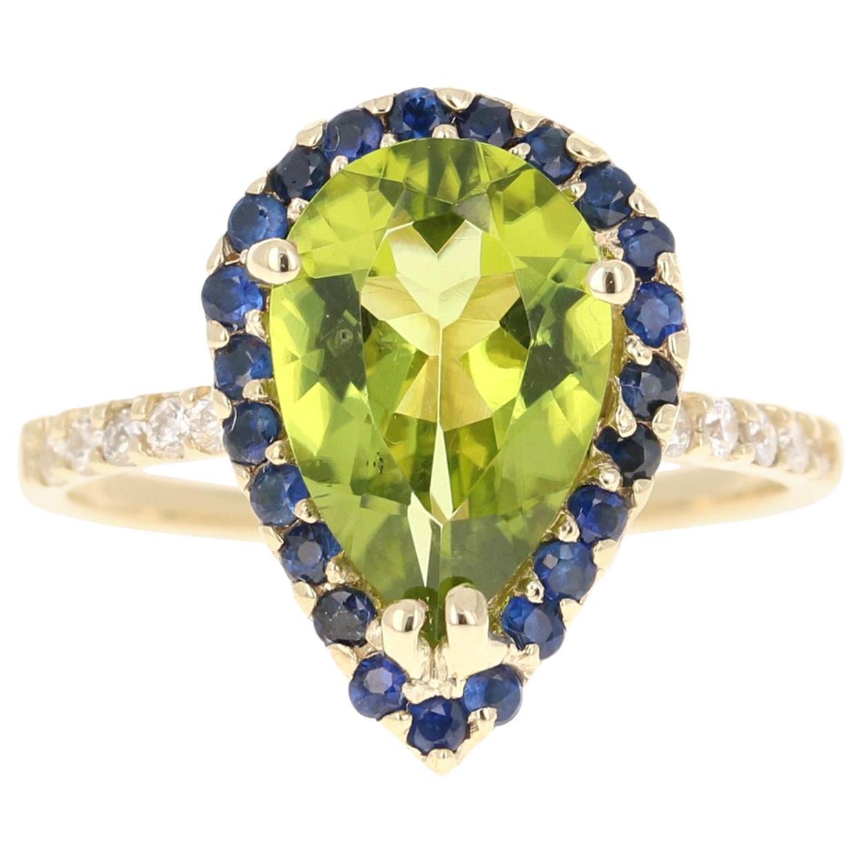 3.42 Carat Peridot Diamond Sapphire 14 Karat Yellow Gold Ring