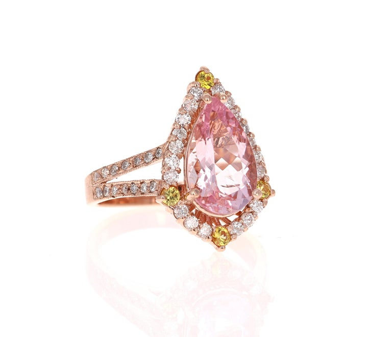 A lovely Engagement Ring Option or as an alternate to a Pink Diamond Ring!   This gorgeous and classy Morganite, Yellow Sapphire and Diamond Ring has a 2.59 Carat Pear Cut Pink Morganite and has 48 Round Cut Diamonds that weigh 0.65 Carats (Clarity: