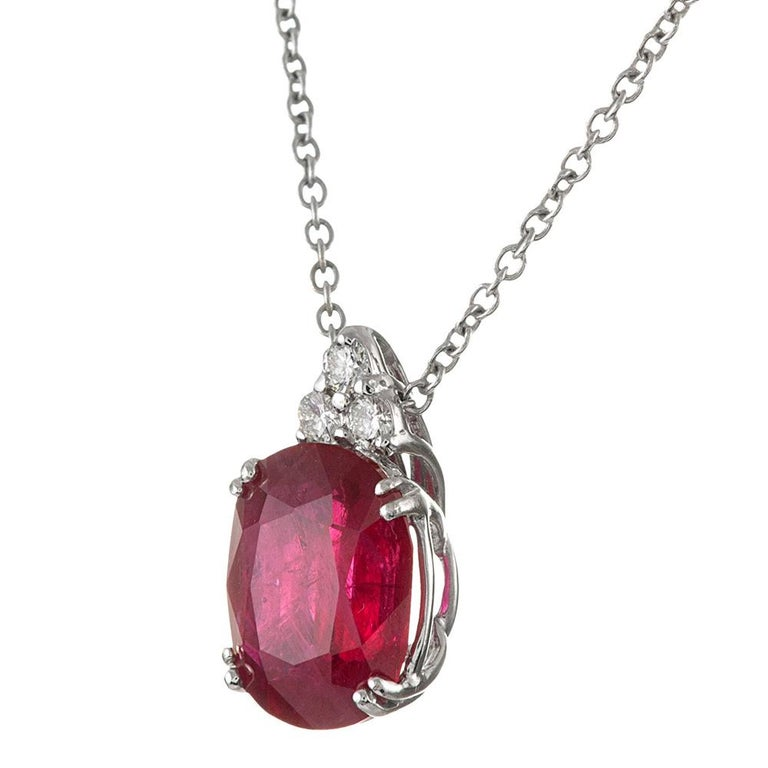 Elegant simplicity is offered by this classically styled diamond solitaire pendant. The ruby weighs 3.43 carats and is suspended from a triangular bale made of three white diamonds. The piece is accompanied by an IGI appraisal report and mounted in