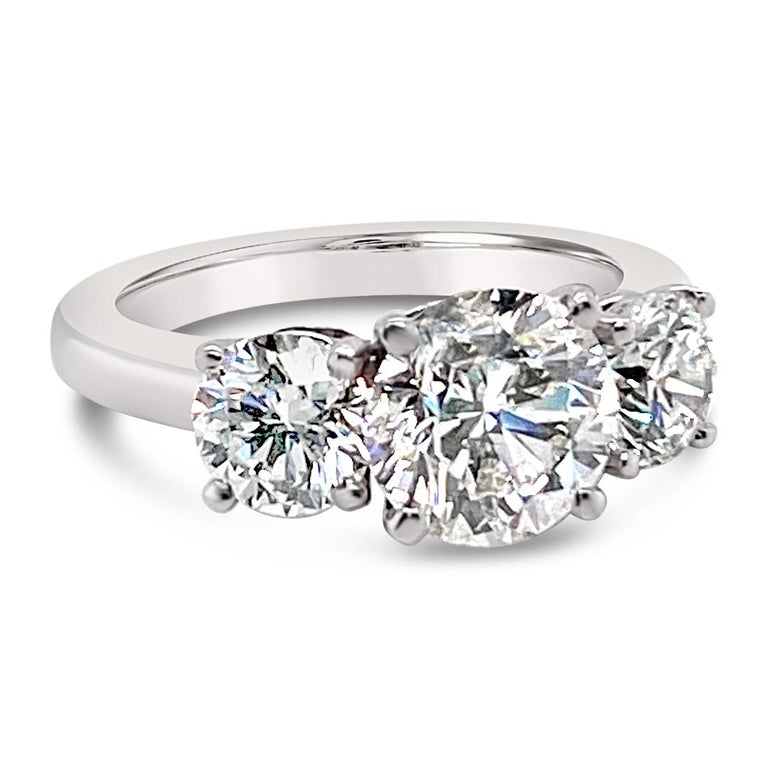 3.43 Carats (total weight) Three Stone Diamond ring.  Center diamond is a 2.01 Carats Round Brilliant cut with EGL-certification: Color G and Clarity SI-2.  Two side diamonds weigh 1.42 Carats in total.  Set in Platinum.