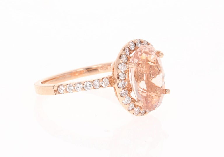 Gorgeous and Classy  Morganite Diamond Ring!   This Morganite ring has a beautiful 2.92 Carat Oval Cut Morganite and is surrounded by a simple halo of  32 Round Cut Diamonds that weigh 0.52 Carats.  The diamonds have a clarity and color of SI-F. The