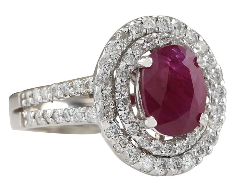 Stamped: 18K White Gold Total Ring Weight: 7.5 Grams Ring Length: N/A Ring Width: N/A Gemstone Weight: Total Natural Ruby Weight is 2.34 Carat (Measures: 9.03x7.05 mm) Color: Red Diamond Weight: Total Natural Diamond Weight is 1.10 Carat Color: F-G,