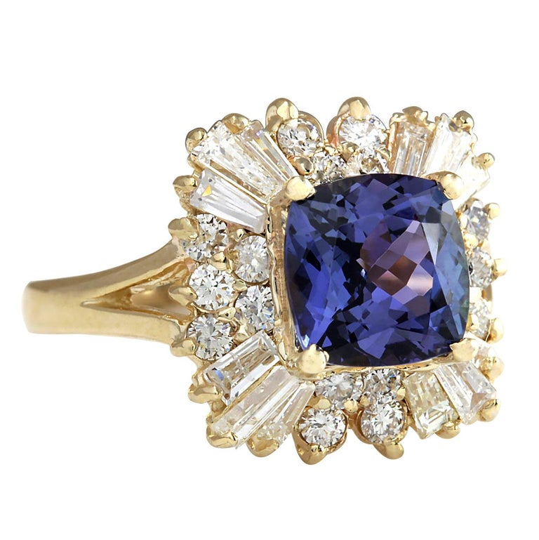 Stamped: 18K Yellow Gold Total Ring Weight: 5.2 Grams Ring Length: N/A Ring Width: N/A Gemstone Weight: Total Natural Tanzanite Weight is 2.18 Carat (Measures: 7.86x7.80 mm) Color: Blue Diamond Weight: Total Natural Diamond Weight is 1.26
