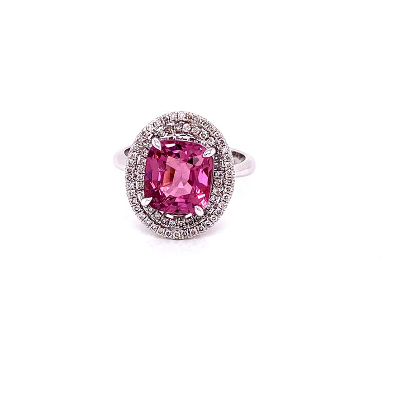 3.44 Carat Unheated Burmese Pink Spinel and White Diamond Gold Engagement Ring:  An elegant ring, it features a 3.44 carat unheated Burmese Spinel, surrounded by two rounds of halo of white round brilliant diamonds. The natural spinel, hailing from