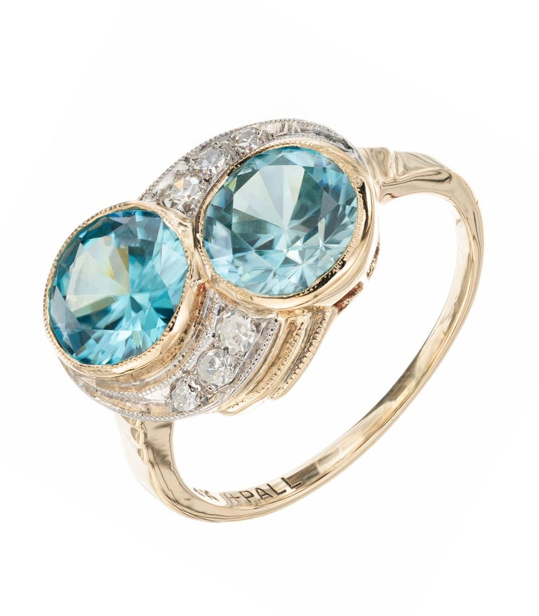 Zircon and diamond engagement ring. 2 round blue zircons set in 14k yellow gold with 6 single cut accent diamonds set in pallidum. Circa 1940's.  2 round greenish blue zircon, VS approx. 3.44cts 6 single cut diamonds, H-I SI approx. .8cts Size 5.5