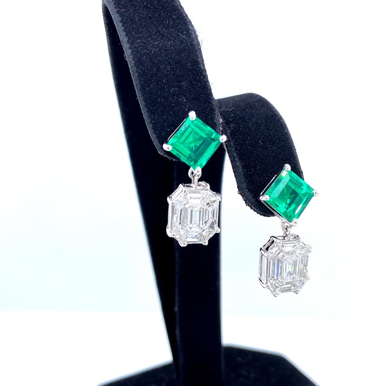 3.45 Carat Emerald And White Diamond Gold Earrings:  An elegant pair of earrings, it features 3.45 carat of green Emerald beryl and 2.25 carat of illusion-set white diamonds! The emerald beryls are of fine quality and colour, with superb brilliance