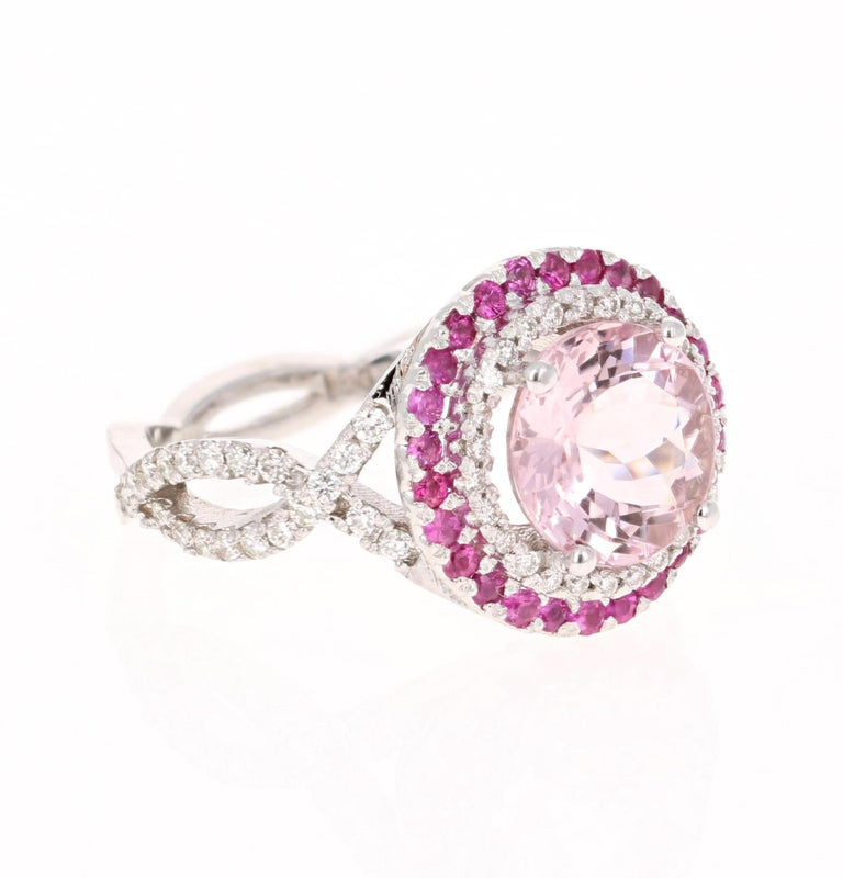 A lovely Engagement Ring Option or as an alternate to a Pink Diamond Ring!   This gorgeous and classy Morganite and Diamond Ring has a 2.44 Carat Round Cut Pink Morganite and is surrounded by a simple halo of 28 Round Cut Diamonds that weigh 0.13