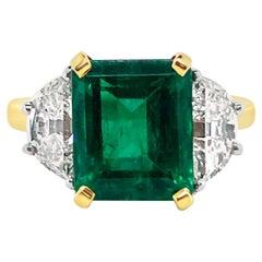 3.46 Carat Emerald and Diamond Ring in 18 Karat Yellow Gold and Platinum