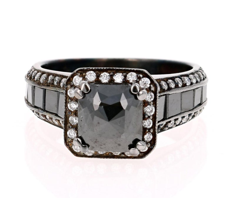 Truly a unique piece!!  A Black and White Diamond Ring in a Black Rhodium finish for a Vintage-Inspired look. This ring has a 1.50 carat Black Diamond in the center of the ring which is surrounded by 72 Round Cut Diamonds that weigh 0.44 Carats.  On