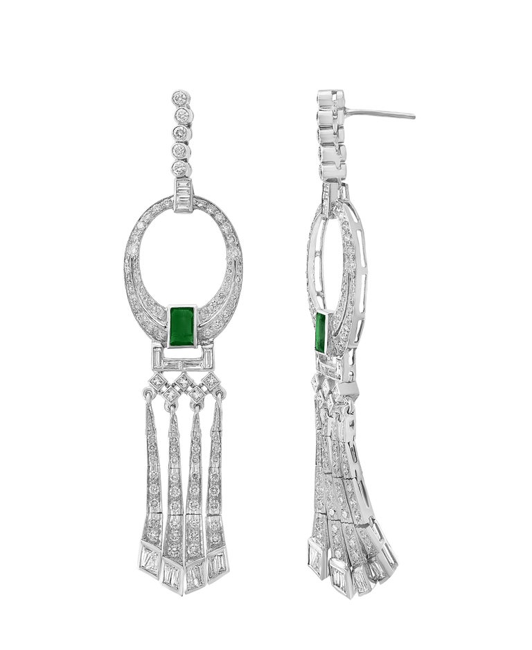 3.5 Carat Colombian Emerald Cut Emerald Diamond  Hanging Earrings in platinum This exquisite pair of earrings are beautifully crafted with Platinum weighing  35 grams Two fine Natural  Colombian  Emerald  Cut Emeralds weighing approximately 3.5
