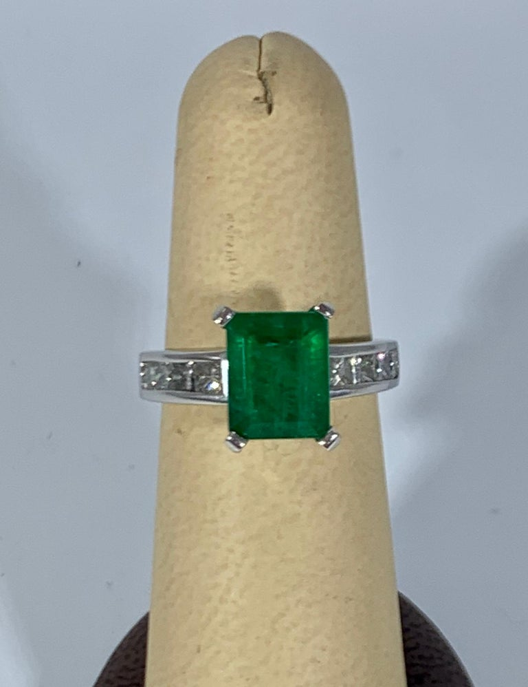 3.5 Carat Emerald Cut Emerald and 0.5 Carat Diamond Ring 14 Karat White Gold In Excellent Condition For Sale In Scarsdale, NY