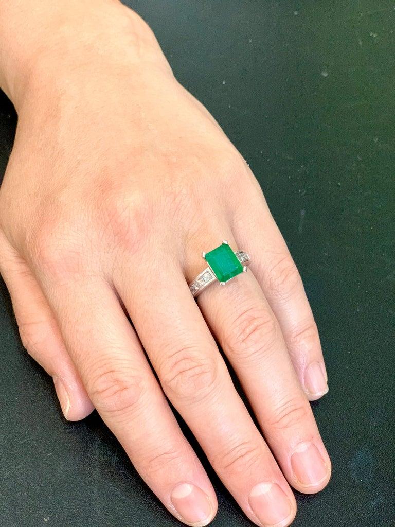 Women's 3.5 Carat Emerald Cut Emerald and 0.5 Carat Diamond Ring 14 Karat White Gold For Sale