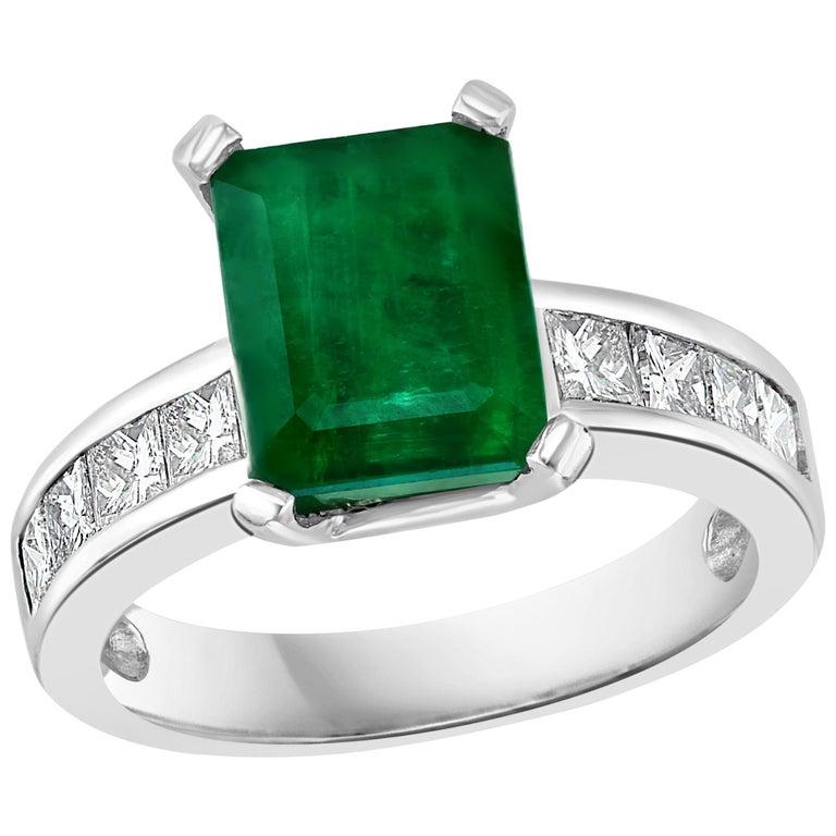 3.5 Carat Emerald Cut Emerald and 0.5 Carat Diamond Ring 14 Karat White Gold For Sale