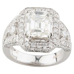 3.5 Carat Emerald Cut Solitaire Engagement Ring with Accent Stones in White Gold