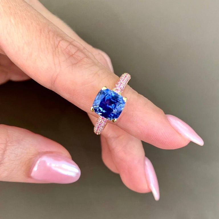 What can be more beautiful than cornflower blue natural sapphire,  only blue sapphire together with small pink sapphires.  You could see how nice and delicate they are looking together.  Pink pave gives to this ring unusual and fresh look.  If you